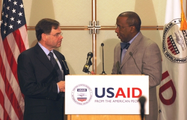 Locher is introduced by Acting USAID Administrator Alonzo Fulgham